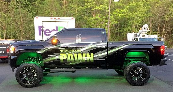 Partial vehicle wrap for Silas Deane Pawn in Manchester, CT.